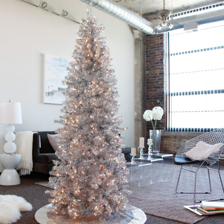 a tall shiny silver tree will perfecly fit a modern space, just add some lights for a sparkling look