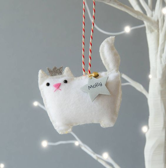 a white princess cat ornament of felt, with a bell and a star is a gorgeous personalize idea for Christmas