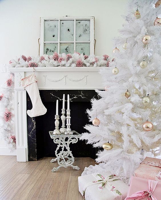 all-white Christmas tree with pastel metallic ornaments looks chic and refined
