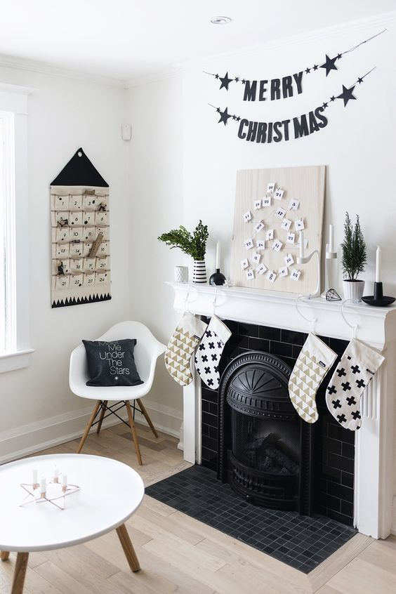 black and white stockings, black garlands, an advent calendar and black and white pillows