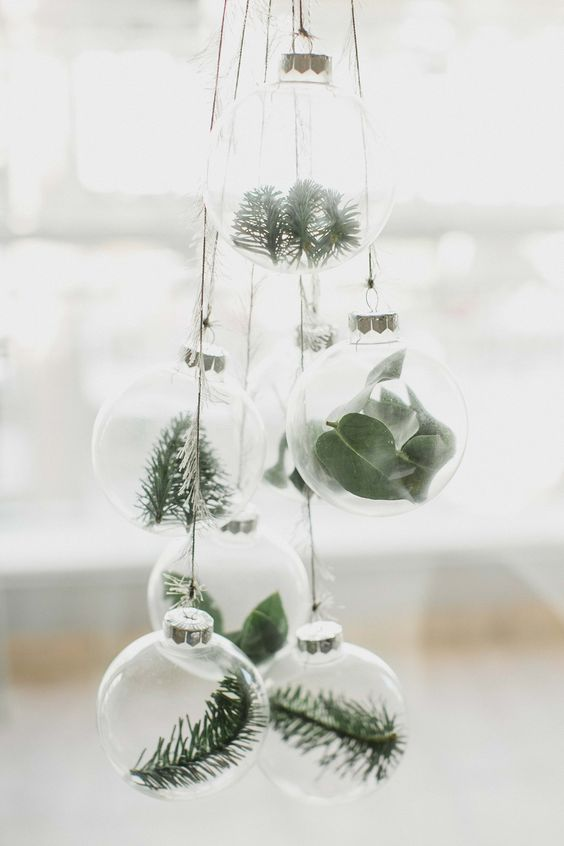 clear glass ornaments with greenery and evergreens hung in a cluster for a natural feel