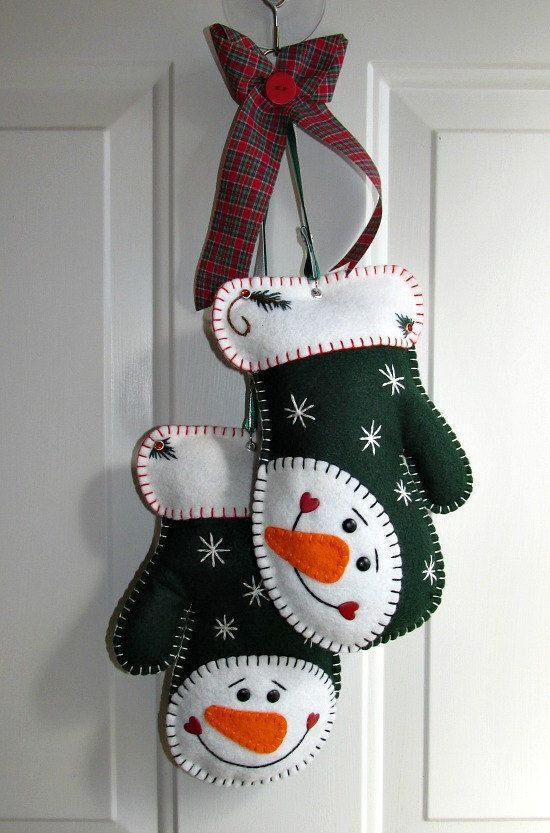green and white felt Christmas mittens with colorful embroidery and beads are cool not only for tree decor but also for front doors