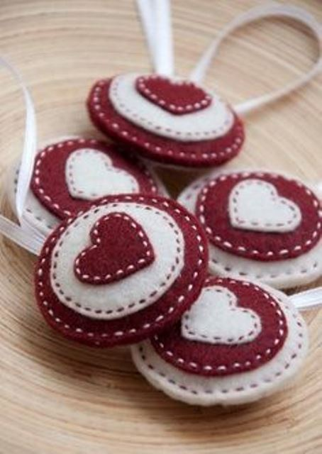 red and white Christmas felt ornaments with hearts are lovely and bright and will bring in some color to the tree