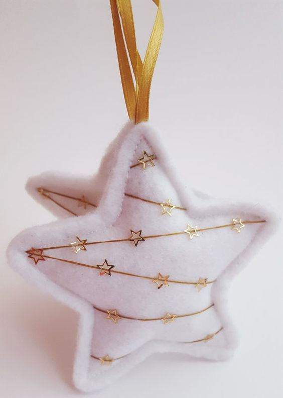 white felt stars with gold embroidery are lovely and chic Christmassy ornaments you can easily make