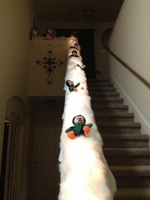 Turning staircase's banister into penguins sled is a great idea for those who want to make your decor more fun.