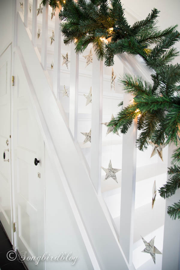 Folded music sheet stars are a great way to spice up a simple garland on a staircase.