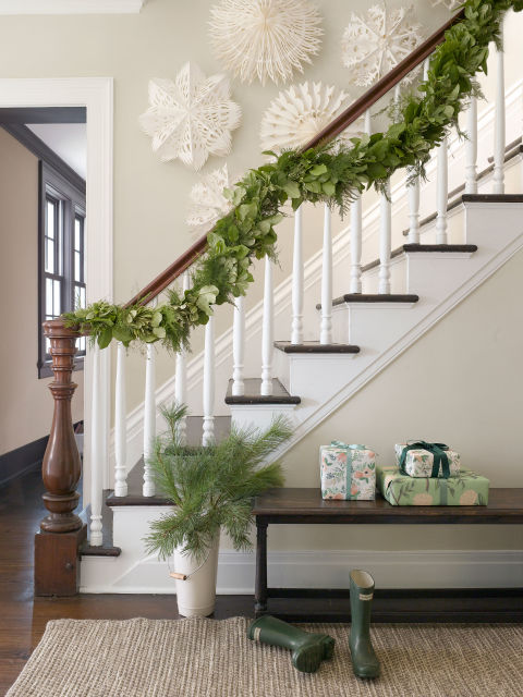 Garland that incorporates fresh asparagus ferns and evergreen shrubs is an interesting alternative to standard pine swags.