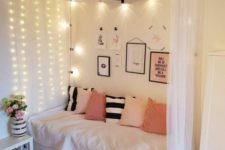 a canopy with lighting on one side of the bed and over it, too