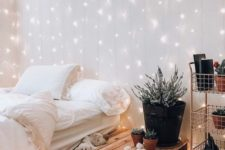 a lighting curtain on the headboard wall is a very cute idea that will catch an eye every time