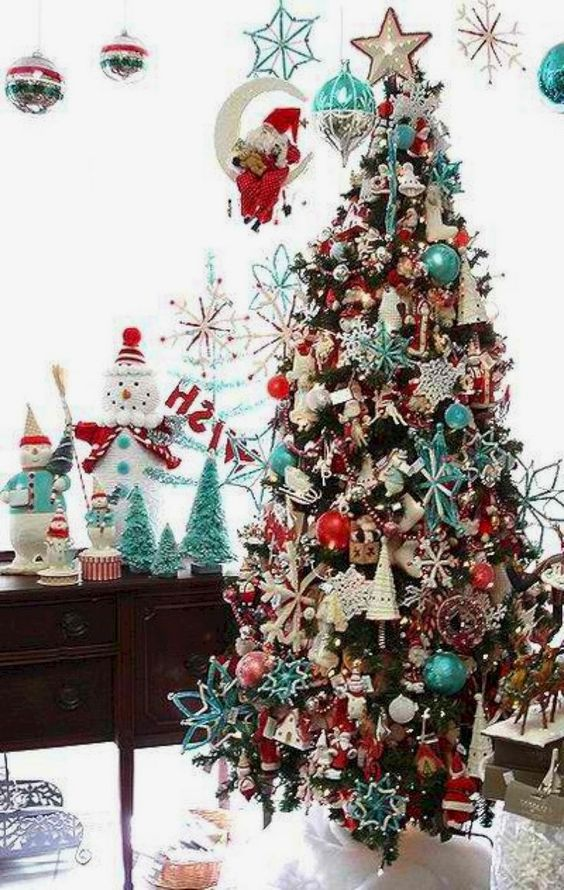 a retro Christmas tree decorated with blue, red and white ornaments so densely that the tree isn't seen at all