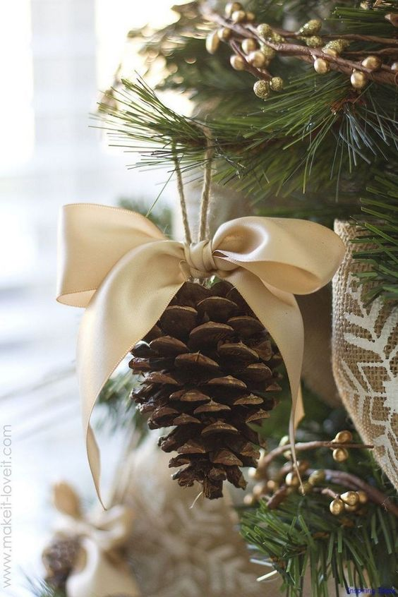a rustic Christmas ornament of a pinecone with a large silk bow is an easy DIY