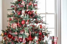 a vintage-inspired Christmas tree with red ornaments, lights and candy candes looks bold and catchy