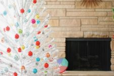 a white Christmas tree with lots of colorful Christmas ornaments looks pretty, chic and vintage