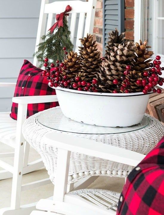 a white bathtub with oversized pinecones, berries is a bold outdoor Christmas decoration to go for