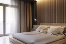 hidden lighting over the bed is a very modern and bold solution