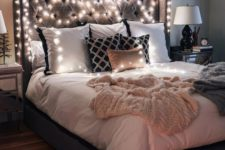 lights covering the headboard is a very cool and simple idea to brign much light into your bedroom