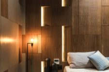 lights integrated into the wall panels make the space look modern and bold