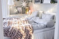lights over the bed and around plus a dreamy paper lantern