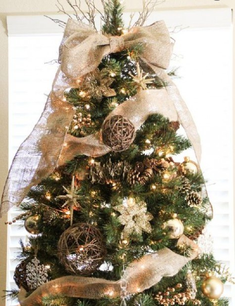 rustic Christmas tree styling with lights, gold ornaments, pinecones, vine balls, burlap ribbons and bows