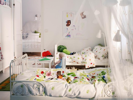 all white shared kids bedroom located right next to the master bedroom canopies make