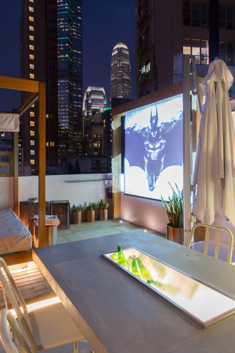 A movie screen would be a perfect addition to summer gatherings.