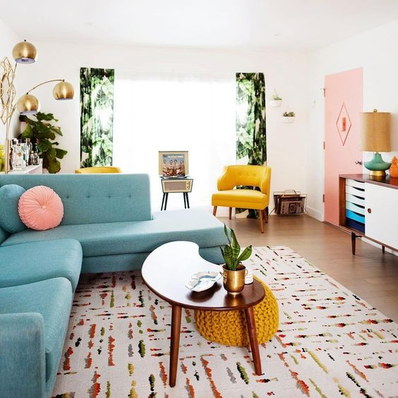 a colorful living room with pink, yellow, blue, green and lots of prints and textures plus metallic touches