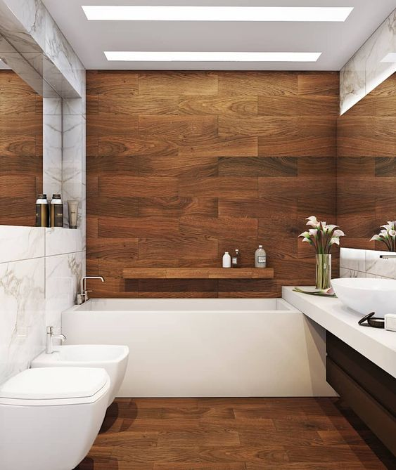 a contemporary bathroom clad with rich stained wood, with a black vanity, white appliances and skylights is very chic