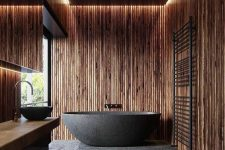 a wooden bathroom design with a moody look