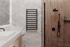 a minimalist bathroom done with light stained wood and white stone tiles, with a wooden vanity and black fixtures