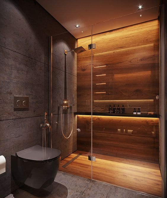 a minimalist moody bathroom with a shower space clad with wood, with built-in lights, with grey stone tiles