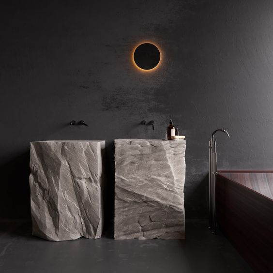 two free-standing sinks cut out of rough stone looks extremely spectacular and super bold