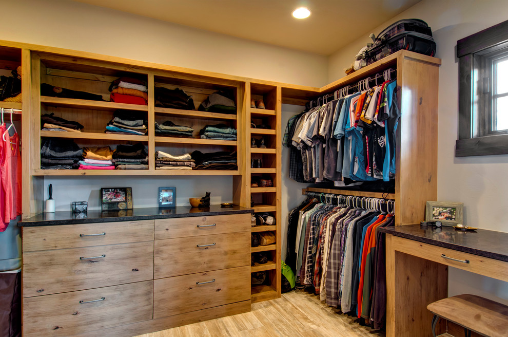 Solid wood cabinetry is a classic way to go for walk-in closets.