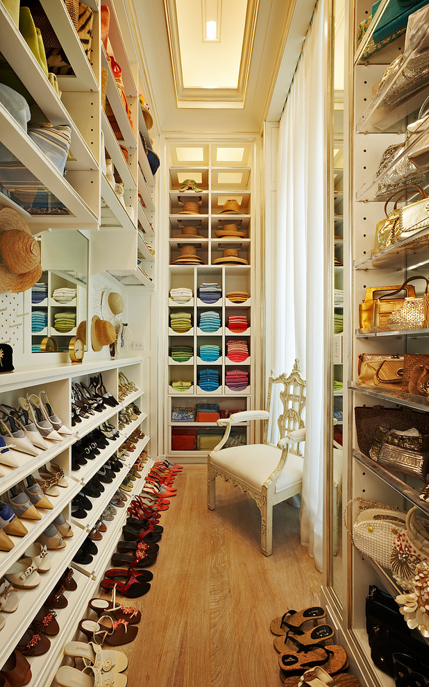 organizing a walk in wardrobe by object and color would make it looks like a