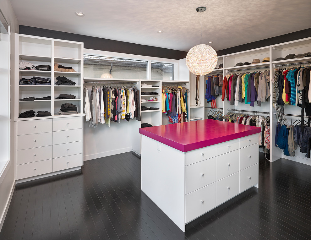 Lacquered MDF countertop in bright pink makes the island a focal point of this walk-in.