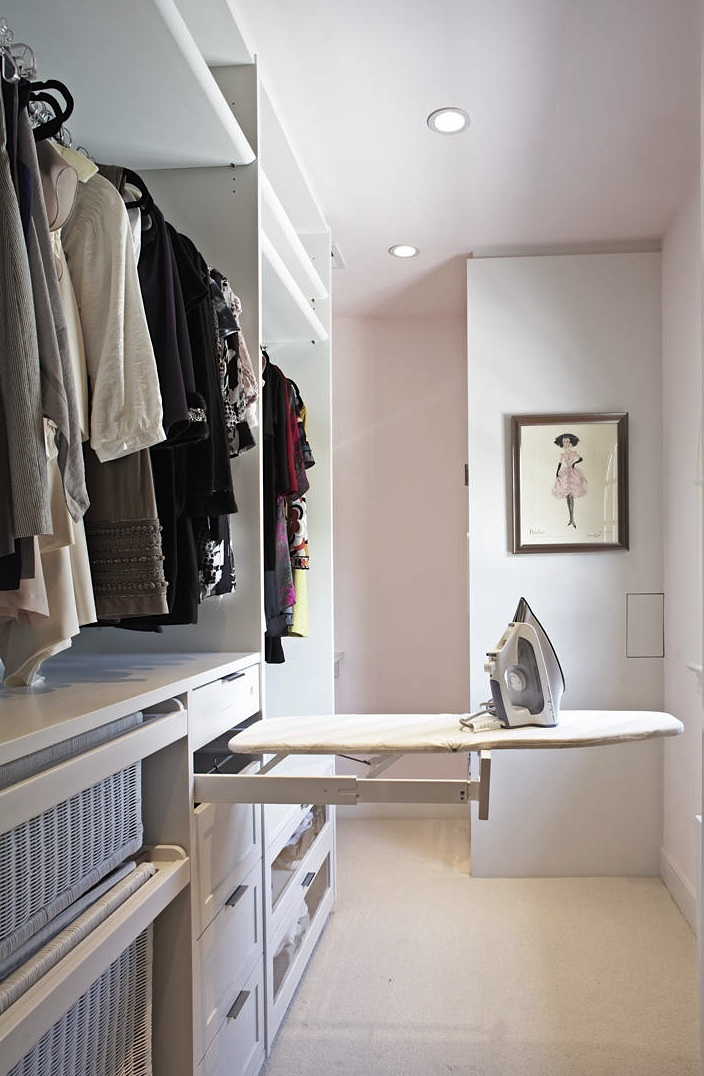 Pullout ironing board is an ideal space saving solution for small walk-ins.