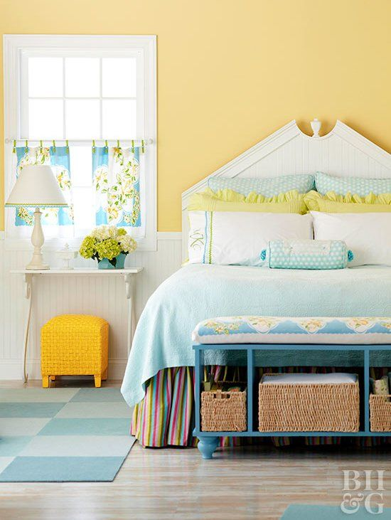 a blue bedding set, a sunny yellow stool, some lemon pillows and floral curtains for a vintage spring bedroom