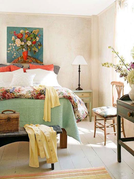 a bright artwork, printed bedding and sunny yellow touches for strong spring spirit in the space