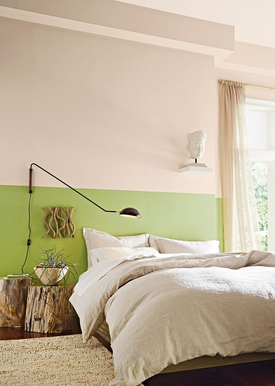 a bright green touch on the wall, tree stumps as side tables and a branch artwork for a fresh spring feel in a modern way