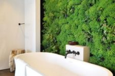 a contemporary bathroom in neutrals with a living wall that takes over the whole space at once