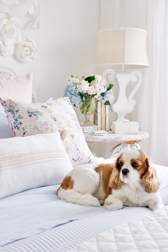 a floral pillow and soem pastel bloms in a vase are all you need for a slight elegant spring touch