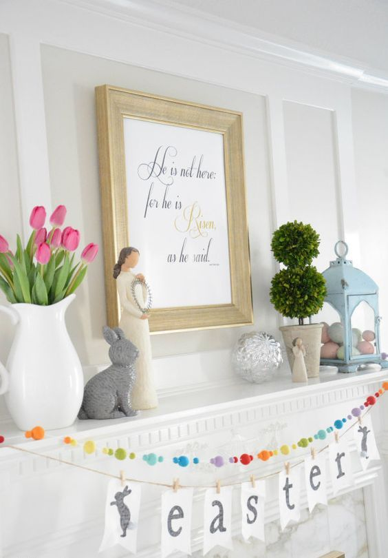 a pastel Easter mantel with a tulip arrangement, a blue lantern with faux eggs, topiaries and a bead garland and bunting