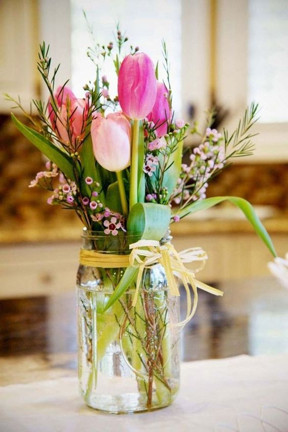 a simple flower arrangement in pink and green in a jar is a cool idea that you may make yourself very fast