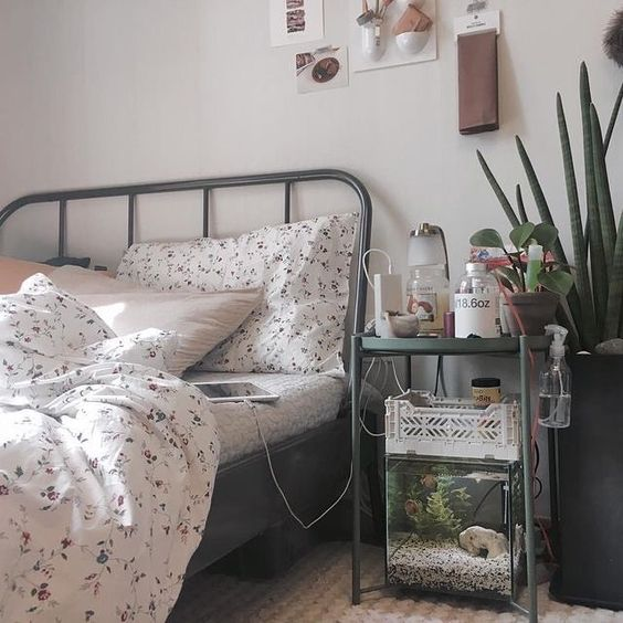 a small aquarium under the nightstannd is a lovely and cool touch of nature for your bedroom