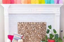 a very simple and cute Easter mantel done with rainbow-colored cardboard eggs to add color