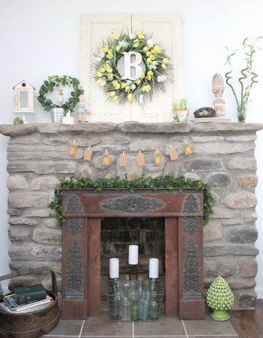a vintage Easter mantel with a tulip wreath, a greenery wreath, a carrot bunting and some faux eggs