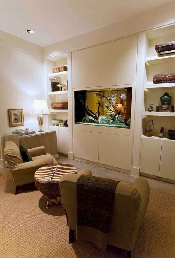 an eclectic neutral living room with a vuilt-in fish tank instead of a TV is a very natural and cozy idea