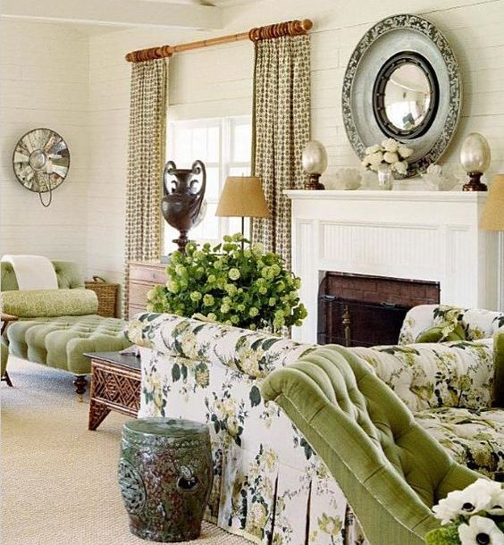 an elegant vintage living room in neutrals, with green and floral touches, green and neutral blooms