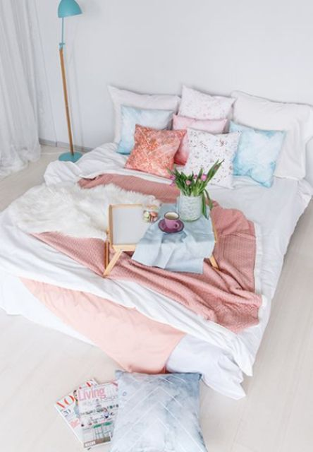 blue, pink and floral bedding is a simple and easy idea to bring a spring feel to the space without wasting much money