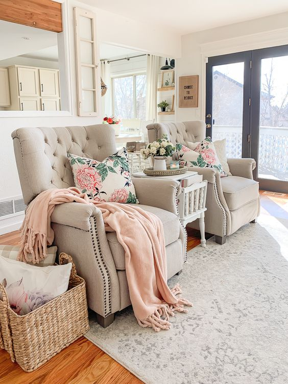 make your living room spring-like with pink and floral touches, for example, linens like here