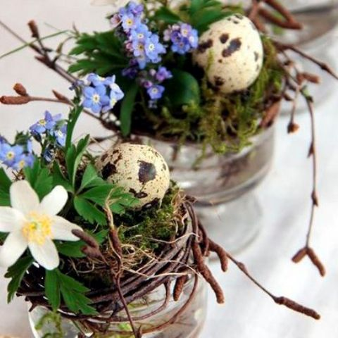 nests with moss, blue and white blooms and faux speckled eggs is a cool idea